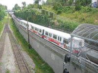 A Mark I train passing by in the Grandview Cut between VCC–Clark and Commercial–Broadway stations