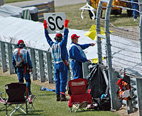 A sign announcing that the safety car (SC) is deployed