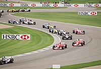 Cars wind through the infield section of the Indianapolis Motor Speedway at the 2003 United States Grand Prix