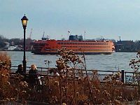 The Staten Island Ferry, seen from the Battery, crosses Upper New York Bay, providing free public transportation between Staten Island and Manhattan.