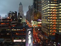 """Eighth Avenue, looking northward (""""Uptown""""), in the rain; most streets and avenues in Manhattan's grid plan incorporate a one-way traffic configuration"""