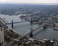 The Brooklyn Bridge in the foreground and the Manhattan Bridge beyond it, are two of the three bridges that connect Lower Manhattan with Brooklyn over the East River.