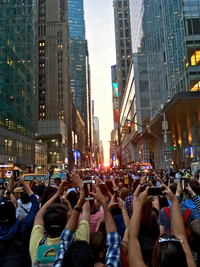 Tourists looking westward at sunset to observe the July 12, 2016 Manhattanhenge