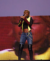 Blige performing during the NFL Kickoff Game in September 2003 in Washington, D.C.