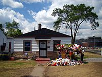 Jackson's childhood home in Gary, Indiana, pictured in March 2010 with floral tributes after his death