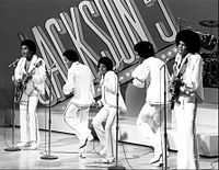 Jackson (center) as a member of the Jackson 5 in 1972. The group were among the first African American performers to attain a crossover following.