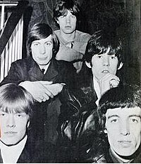 Jagger with the Rolling Stones in 1965. Clockwise from lower left: Brian Jones, Charlie Watts, Mick Jagger, Keith Richards, Bill Wyman
