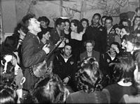 Pete Seeger entertaining Eleanor Roosevelt (center), honored guest at a racially integrated Valentine's Day party marking the opening of the United Federal Labor Canteen, CIO, in then-segregated Washington, D.C., 1944.