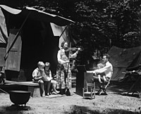 Peter Seeger (on father's lap) with his father and mother, Charles and Constance Seeger and brothers on a camping trip (May 23, 1921)