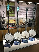 Four long-neck banjos inspired by Seeger's. The instrument on far left was closely constructed to match Seeger's. American Banjo Museum.