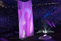 Justin Timberlake performs on piano alongside projected archive footage of Prince during the Super Bowl LII halftime show.