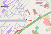 A map showing the location of the plane (blue dot) after landing and sliding through the field on the runway safety area – route marked in red.