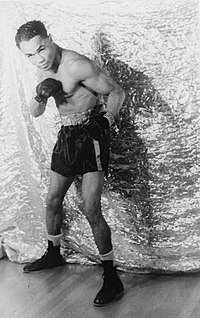 Henry Armstrong was known for his aggressive, non-stop assault style of fighting.