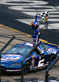 Busch celebrating after winning the 2006 Food City 500.