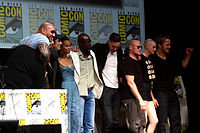 The cast and crew of Guardians of the Galaxy at the 2013 San Diego Comic-Con (L-R: producer Kevin Feige, Bautista, director James Gunn, del Toro, Saldana, Hounsou, Pace, Rooker, Gillan, and Pratt)