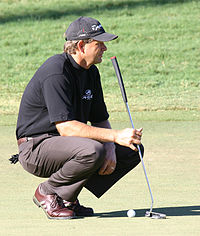Goosen looking over a putt at the 2006 Chrysler Championship