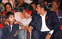 Khan (right) with Saif Ali Khan at an event for World Aids Day in 2007
