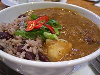 Jamaican curry goat with rice and peas