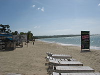 A beach in Negril with a hotel and restaurant