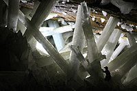 Naica Mine is known for its extraordinary selenite crystals and is a major source of lead, zinc, and silver operated by Industrias Peñoles.