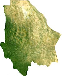 Satellite image of the state of Chihuahua shows the varying terrain from the green alpine mountains in the southwest, to the steppe highlands in the center, to the desert in the east.