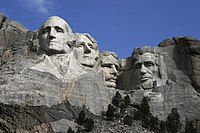 (left to right) George Washington, Thomas Jefferson, Theodore Roosevelt and Abraham Lincoln sculpted into Mount Rushmore
