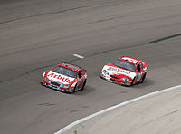 Denny Hamlin's No. 20 Busch car (right) battling Matt Kenseth (left) for position.