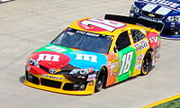 Kyle Busch driving the No. 18 M&Ms car in the 2013 STP Gas Booster 500 at Martinsville