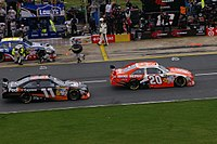 Joey Logano (right) and Denny Hamlin (left) on pit road during the 2009 Coca-Cola 600.