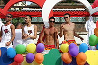 Gay men on a pride parade float in Rome.