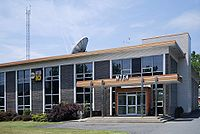 WTEN (headquarters pictured), WXXA, and Spectrum News broadcast from within city limits.