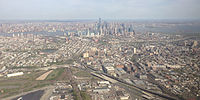 View of Jersey City from the northwest. Lower Manhattan is in the background.