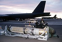 A CAPTOR mine being loaded onto a B-52 Stratofortress at Loring Air Force Base