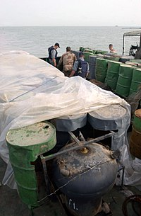 Camouflaged Iraqi mines hidden inside oil barrels on a shipping barge in the Persian Gulf, 2003.