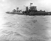Minesweeper after striking a mine off Utah Beach, 7 June 1944. Note her broken back, with smoke pouring from amidships.