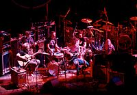 An acoustic performance at the Warfield Theatre in San Francisco in 1980. Left to right: Garcia, Lesh, Kreutzmann, Weir, Hart, Mydland.