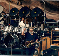 Grateful Dead performing at Red Rocks Amphitheatre in 1987: Jerry Garcia (custom Tiger guitar), Mickey Hart (drums).
