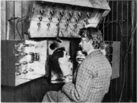 """Baird in 1925 with his televisor equipment and dummies """"James"""" and """"Stooky Bill"""" (right)."""