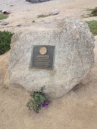 The plaque marking the location of Denver's plane crash in Pacific Grove, California