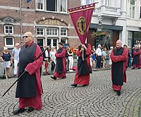 Confraternity of the Holy Cross with banner