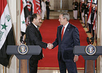 President Bush and Iraqi Prime Minister Nouri al-Maliki shake hands in July 2006