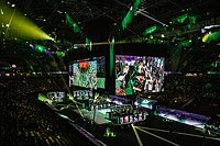 The largest Dota 2 tournaments often have prize pools totaling millions of dollars. Shown here is The International 2018, a $25 million tournament hosted at the Rogers Arena in Vancouver.