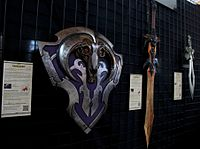 Physical props, based on items from the game, being sold as merchandise at The International 2012
