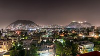 Night scene in Kabul in 2016, with three mountains visible