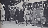 Men and women entering a public transport bus in the 1950s