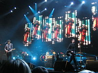 """Snow Patrol performing in 2009. Their 2006 single, """"Chasing Cars"""", is the most widely played song on UK radio in the 21st century."""