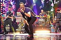 Coldplay, the most commercially successful post-Britpop band, on stage in 2016. Their first three albums—Parachutes (2000), A Rush of Blood to the Head (2002), and X&Y (2005)—are among the best-selling albums in UK chart history.