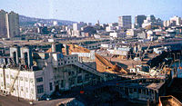 1966 photo shows sawdust-fired power plant on the edge of downtown that was removed to make way for dense residential development. High rises to left in background were early projects of the Portland Development Commission