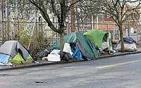 Tent camps setup on the sidewalk in the Lloyd District neighborhood.