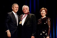 Cash with President George W. Bush and First Lady Laura Bush in 2002